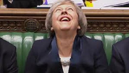 Theresa May laughing